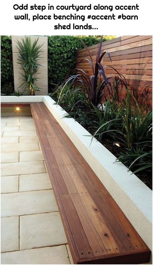 Odd step in courtyard along accent wall, place benching #accent #barn shed lands...